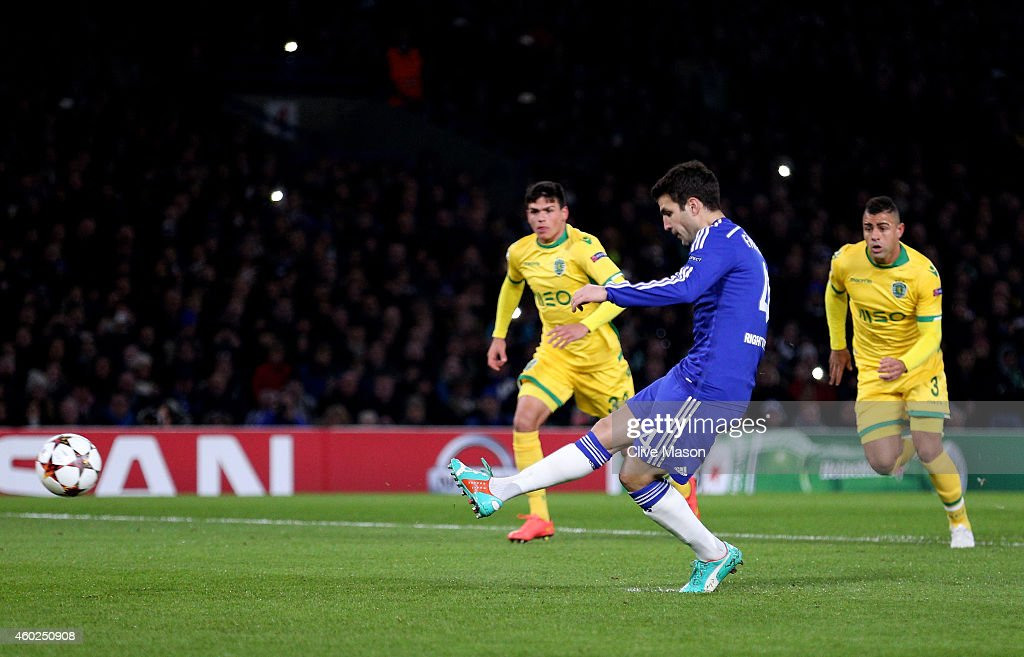 Cesc Fabregas of Chelsea scores the openiung goal from the penalty spot during the UEFA Champions League group G match between Chelsea and Sporting Clube de Portugal at Stamford Bridge on December 10, 2014 in London, United Kingdom.