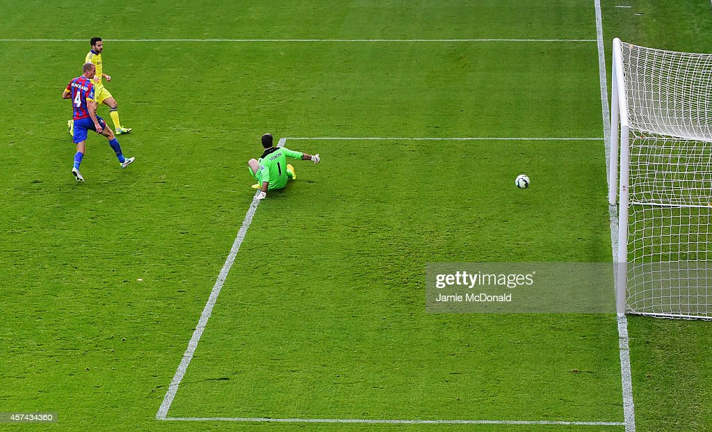 Cesc Fabregas of Chelsea shoots past Julian Speroni of Crystal Palace as he scores their second goal during the Barclays Premier League match between Crystal Palace and Chelsea at Selhurst Park on October 18, 2014 in London, England.