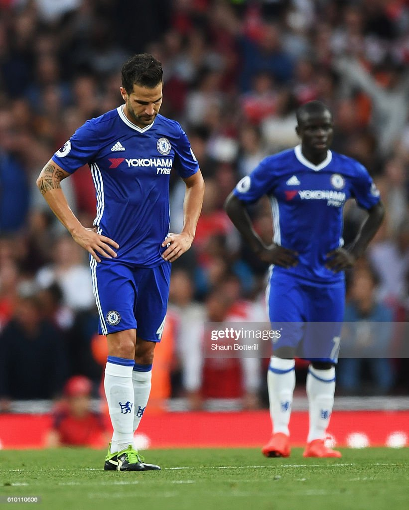 Cesc Fabregas of Chelsea shows dejection after Arsenal score during the Premier League match between Arsenal and Chelsea at the Emirates Stadium on September 24, 2016 in London, England.