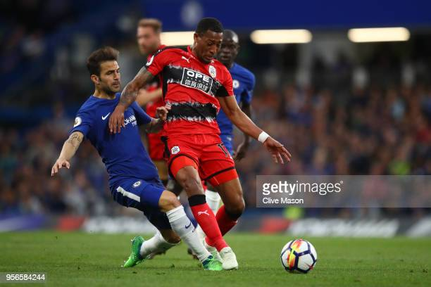 Cesc Fabregas of Chelsea tackles Rajiv van La Parra of Huddersfield Town during the Premier League match between Chelsea and Huddersfield Town at...