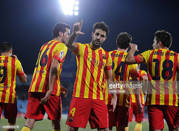 Cesc Fabregas of FC Barcelona celebrates after scoring their fifth goal during the La Liga match between Getafe CF and FC Barcelona at Coliseum...