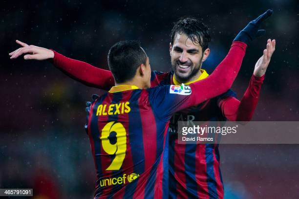Cesc Fabregas of FC Barcelona celebrates with his teammate Alexis Sanchez after scoring his team's fifth goal during the Copa del Rey Quarter Final...