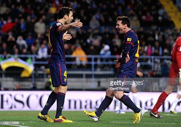 Cesc Fabregas of FC Barcelona celebrates with his teammate Lionel Messi of FC Barcelona after scoring his team's second goalduring the La Liga match...