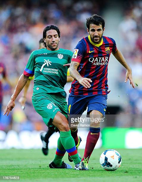 Cesc Fabregas of FC Barcelona competes for the ball Miguel Pallardo Gonzalez of Levante UD during the La Liga match between FC Barcelona and Levante...