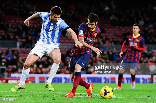 Cesc Fabregas of FC Barcelona duels for the ball with Ignacio Camacho of Malaga CF during the La Liga match between FC Barcelona and Malaga CF at...