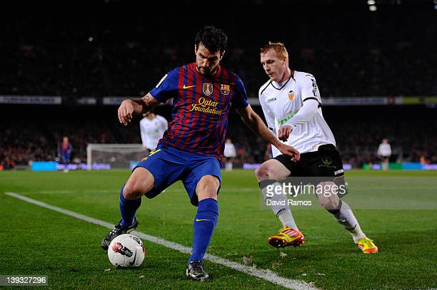 Cesc Fabregas of FC Barcelona duels for the ball with Jeremy Mathieu of Valencia CF during the La Liga match between FC Barcelona and Valencia CF at...