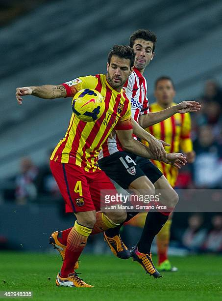 Cesc Fabregas of FC Barcelona duels for the ball with Markel Susaeta of Athletic Club during the La Liga match between Athletic Club and FC Barcelona...