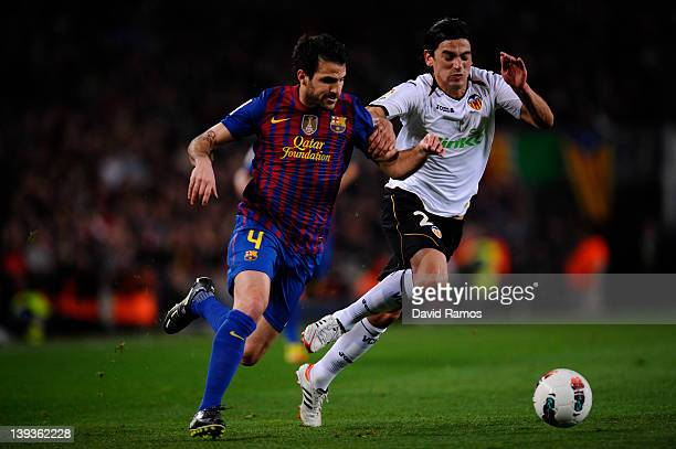 Cesc Fabregas of FC Barcelona duels for the ball with Tino Costa of Valencia CF during the La Liga match between FC Barcelona and Valencia CF at Camp...