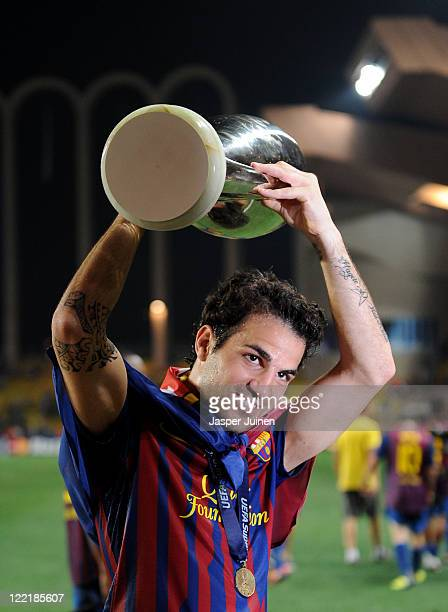 Cesc Fabregas of FC Barcelona holds the trophy aloft during the UEFA Super Cup match between FC Barcelona and FC Porto at Louis II Stadium on August...