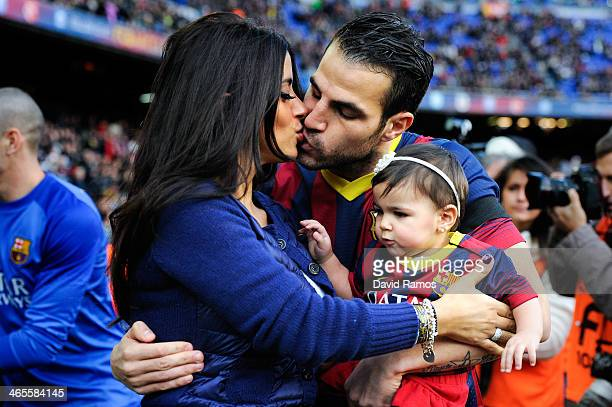 Cesc Fabregas of FC Barcelona kisses his girlfriend Daniella Semaan as he holds his daughter Lia during the La Liga match between FC Barcelona and...