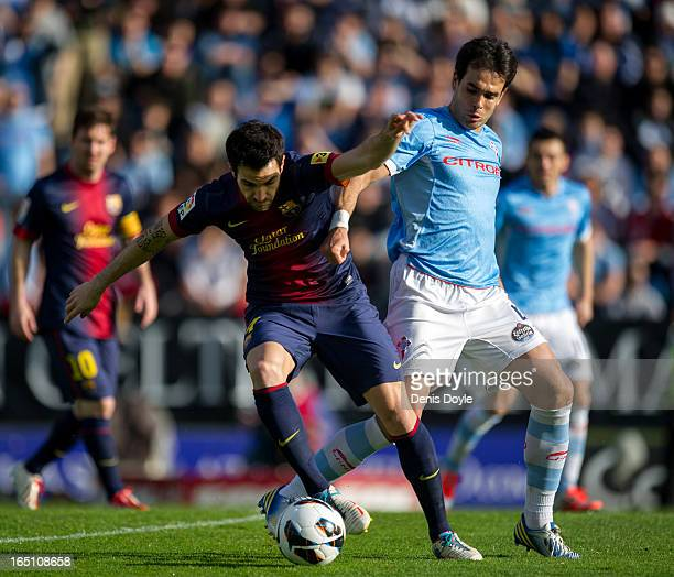 Cesc Fabregas of FC Barcelona moves away from Rogja Oubina of RC Celta de Vigo during the La Liga match between RC Celta de Vigo and FC Barcelona at...