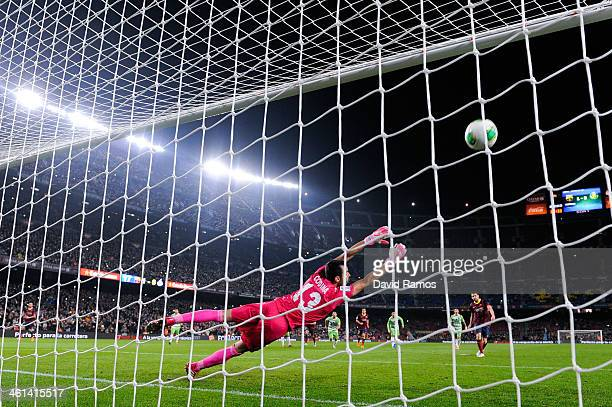 Cesc Fabregas of FC Barcelona scores his team's second goal from the penalty spot during the Copa del Rey round of 16 first leg match between FC...