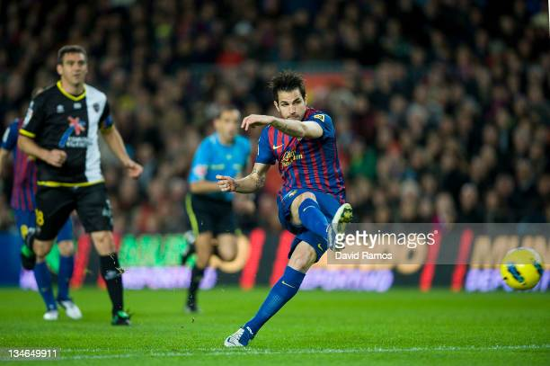 Cesc Fabregas of FC Barcelona scores the opening goal during the La Liga match between FC Barcelona and Levante UD at Camp Nou on December 3, 2011 in...