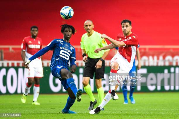 Cesc FABREGAS of Monaco and Eduardo CAMAVINGA of Rennes during the Ligue 1 match between AS Monaco and Stade Rennes at Stade Louis II on October 20...
