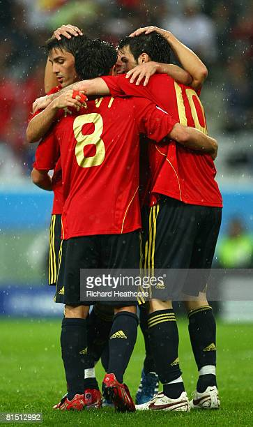 Cesc Fabregas of Spain celebrates scoring a goal with team mates during the UEFA EURO 2008 Group D match between Spain and Russia at Stadion Tivoli...