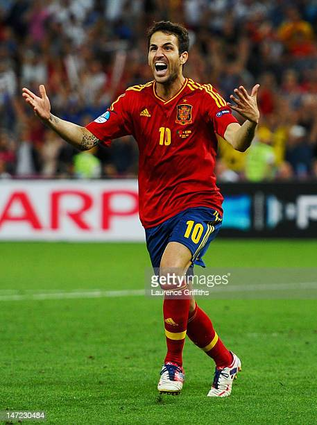 Cesc Fabregas of Spain celebrates scoring the winning penalty during the UEFA EURO 2012 semi final match between Portugal and Spain at Donbass Arena...