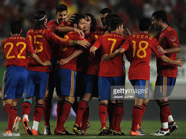 Cesc Fabregas of Spain celebrates scoring with his teammates during the International Friendly match between Spain and Poland at the Estadio Nueva...