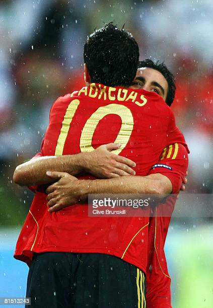 Cesc Fabregas of Spain celebrates victory with Xavi Hernandez after the UEFA EURO 2008 Group D match between Spain and Russia at Stadion Tivoli Neu...
