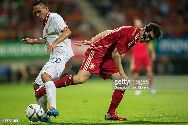 Cesc Fabregas of Spain competes for the ball with David Guzman of Costa Rica during the international friendly match between Spain and Costa Rica at...