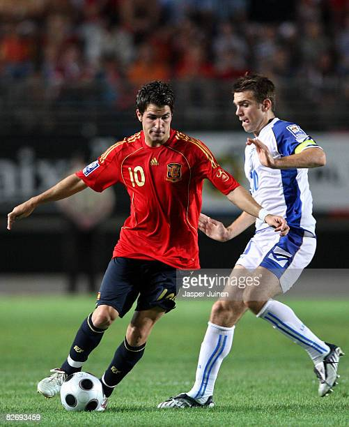 Cesc Fabregas of Spain duels for the ball with Zvjezdan Misimovic of BosniaHerzegovina during the FIFA2010 World Cup Qualifier match between Spain...