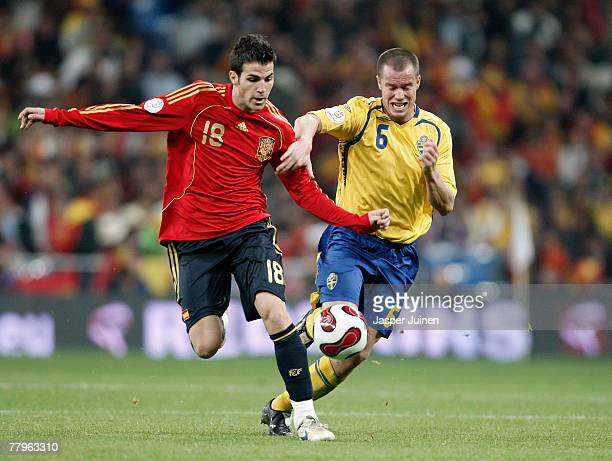 Cesc Fabregas of Spain fights for the ball with Daniel Andersson of Sweden during the Euro 2008 Group F qualifying match between Spain and Sweden at...