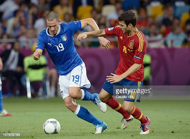 Cesc Fabregas of Spain in action against Leonardo Bonucci of Italy during the UEFA EURO 2012 final match between Spain and Italy at the Olympic...