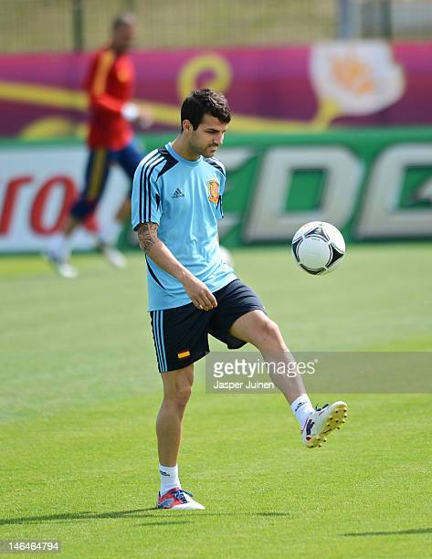Cesc Fabregas of Spain juggles the ball during a training session ahead of their UEFA EURO 2012 group C match against Croatia on June 17 2012 in...