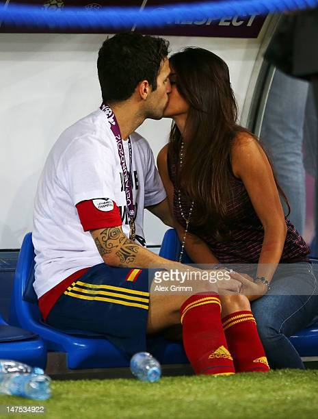 Cesc Fabregas of Spain kisses his girlfriend Daniella Semaan on the substitutes bench following his team's victory in the UEFA EURO 2012 final match...