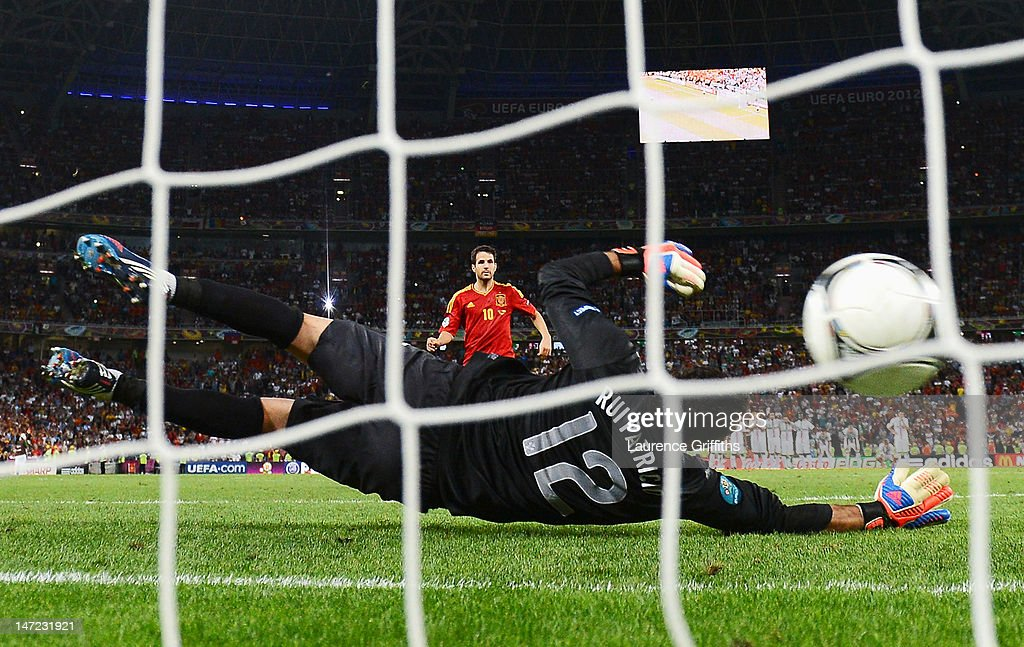 Cesc Fabregas of Spain scores the winning penalty past Rui Patrício of Portugal during the UEFA EURO 2012 semi final match between Portugal and Spain at Donbass Arena on June 27, 2012 in Donetsk, Ukraine.