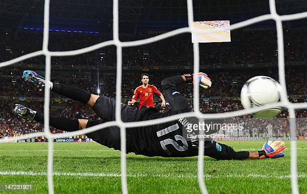 Cesc Fabregas of Spain scores the winning penalty past Rui Patrício of Portugal during the UEFA EURO 2012 semi final match between Portugal and Spain...
