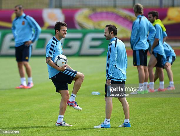 Cesc Fabregas of Spain stands with his teammate Andres Iniesta during a training session ahead of their UEFA EURO 2012 group C match against Croatia...