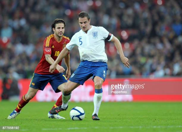 Cesc Fabregas of Spain tracks Phil Jagielka of England during an International Friendly match at Wembley Stadium on November 12 2011 in London England