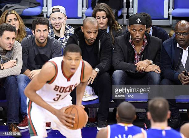 Cesc Fabregas, Thierry Henry and Didier Drogba attend the NBA Global Games match between New York Knicks and Milwaukee Bucks at 02 Arena on January...