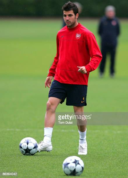 Cesc Fabregas warms up during Arsenal's training session prior to Tuesday's Champions League fixture against Manchester United at London Colney...