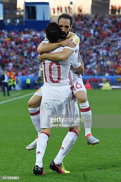 Cesc Febregas of Spain celebrates his team's first goal with his team mate Juanfran during the UEFA EURO 2016 Group D match between Croatia and Spain...
