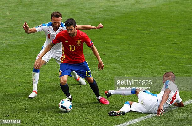 Cesc Febregas of Spain competes for the ball against Theodor Gebre Selassie and Tomas Sivok of Czech Republic during the UEFA EURO 2016 Group D match...