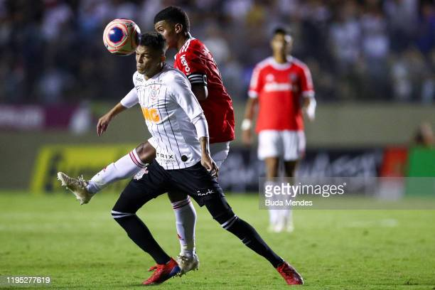 Cesinha of Internacional struggles for the ball with Adson of Corinthians during a match between Internacional and Corinthians as part of Semi-Final...
