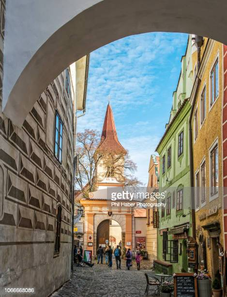 cesky krumlov: street with archway - phil haber stock pictures, royalty-free photos & images