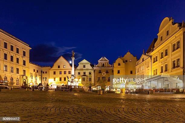 cesky krumlov town square at night, bohemia, czech republic - christine wehrmeier stock photos and pictures