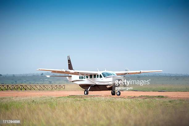 cessna caravan 208 starting on an unpaved airstrip - airfield stock pictures, royalty-free photos & images
