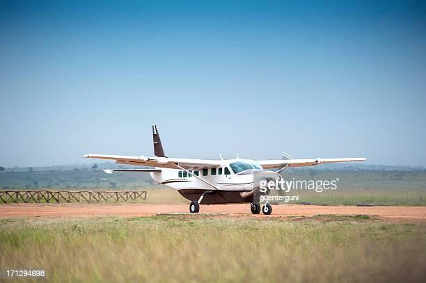 Cessna Caravan 208 starting on an unpaved airstrip