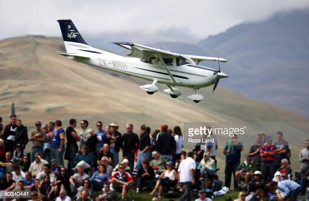 A cessna light aicraft makes a landing behind the crowd during the round six Super 14 match between the Highlanders and the Western Force at the...