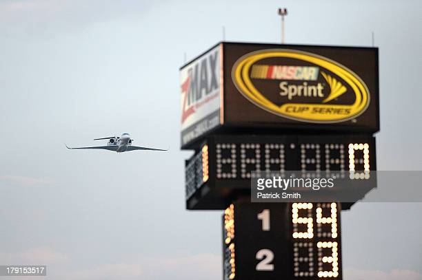 Cessna performs a flyover prior to the NASCAR Nationwide Series Great Clips/Grit Chips 300 at Atlanta Motor Speedway on August 31 2013 in Hampton...