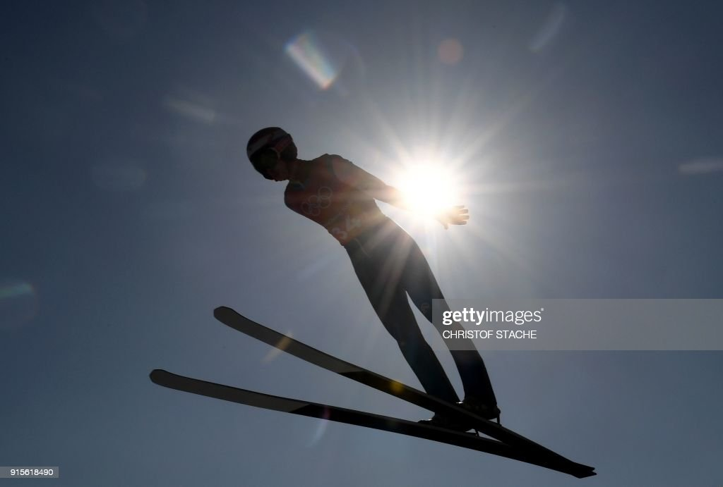 TOPSHOT - Cestmir Kozisek of the Czech Republic soars through the air during a training for the men's normal hill individual ski jumping event during the Pyeongchang 2018 Winter Olympic Games on February 8, 2018, in Pyeongchang. / AFP PHOTO / Christof STACHE