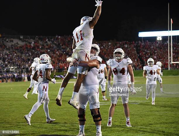 Cethan Carter of the Nebraska Cornhuskers celebrates his touchdown with Nick Gates against the Northwestern Wildcats during the second half on...