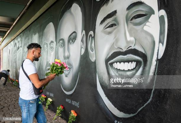 Cetin Gueltekin , the brother of Goekhan Gueltekin lays flowers in front of a 27 meter long street art mural to commemorate the nine victims of the...