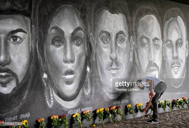 Cetin Gueltekin, the brother of Goekhan Gueltekin lays flowers in front of a 27 meter long street art mural to commemorate the nine victims of the...