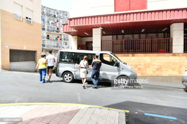 Ceuta's Councillor for the Presidency and Institutional Relations, Maria Isabel Deu , helps Moroccan minors out of a van at the court gates after...