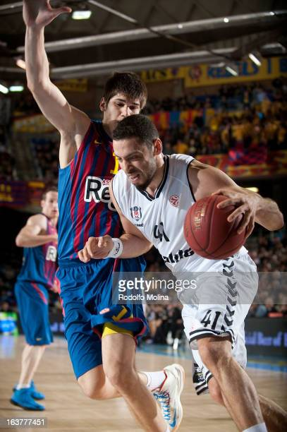 Cevher Ozer #41 of Besiktas JK Istanbul competes with Marko Todorovic #14 of FC Barcelona Regal during the 20122013 Turkish Airlines Euroleague Top...