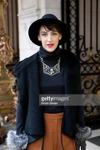 Ceylan Atinc Fashion Editor for Marie Claire Turkey wearing a Burberry handbag at Paris Fashion Week Autumn/Winter 2012 womenswear shows on March 6...